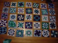 quilt blocks, arranged on a floor